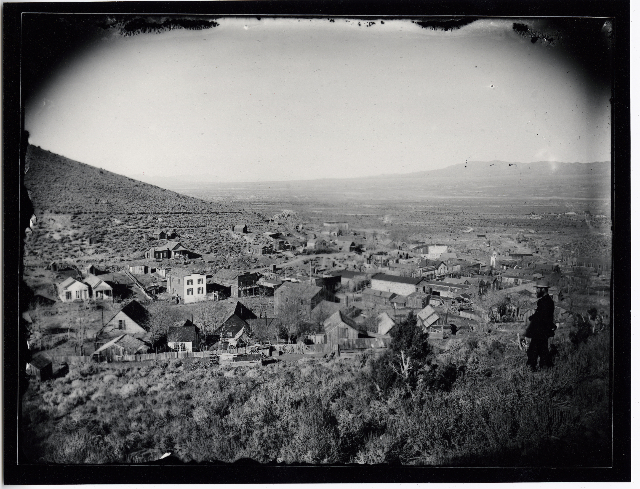A man stands on a rise above the Lincoln County seat of Pioche in this undated photo. The rough and tumble mining town boomed in the late 1800s. (Courtesy of UNLV Special Collections)