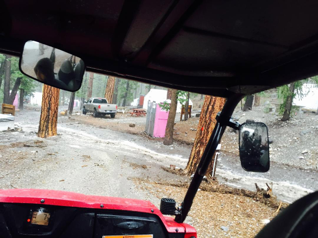Flood waters flow through Camp Stimson on State Route 158. (Courtesy Jana Johns)