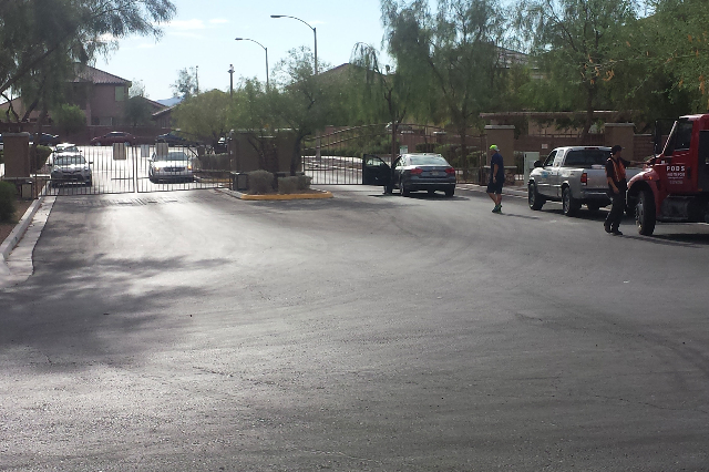 Residents in southwest Las Vegas were unable to enter or exit their neighborhood Thursday morning, Aug. 6, 2015, as a power outage in the area wouldn't let the gates to open. (Graydon Johns/ ...