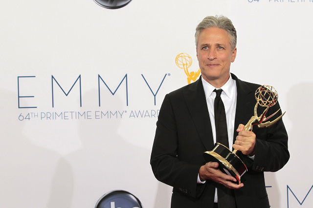 """Jon Stewart hold the Emmy award for outstanding variety series for """"The Daily Show With Jon Stewart"""" at the 64th Primetime Emmy Awards in Los Angeles September 23, 2012. (Mario Anzuoni/R ..."""