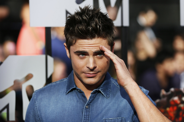 Actor Zac Efron arrives at the 2014 MTV Movie Awards in Los Angeles, California  April 13, 2014.  (Danny Moloshok/Reuters)