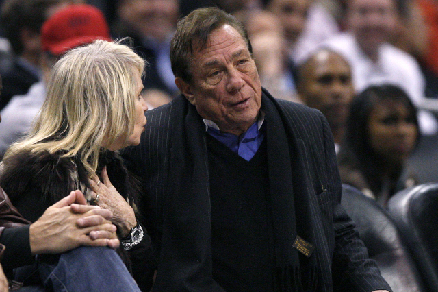 Former Los Angeles Clippers owner Donald Sterling (R) watches the team play New York Knicks in their NBA basketball game in Los Angeles February 11, 2009.  (Lucy Nicholson/Reuters)