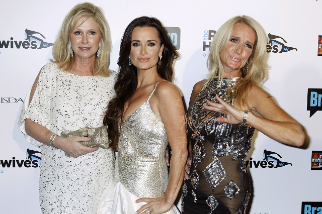 "Sisters and cast members of the Bravo's new reality series ""The Real Housewives of Beverly Hills"" Kyle Richards (C) and Kim Richards (R) pose with their sister Kathy Hilton at the  ..."