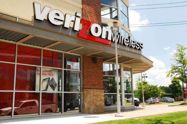 A close up photograph showing the Verizon Wireless logo mounted to the front of a store in Atlanta, Georgia. (Rich Brooks/CNN)