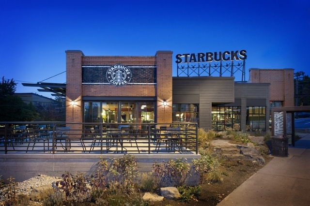 An exterior photograph showing a Starbucks Coffee Company location along Olive Way in Seattle, Washington. (Starbucks/CNN)
