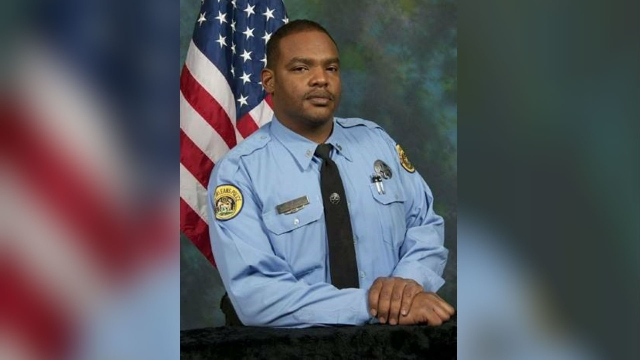 Travis Boys, 33, is accused of killing New Orleans Police Officer Daryle Holloway (shown) Saturday, June 20, 2015. Boys somehow had access to two guns that were found in the dead officer's p ...