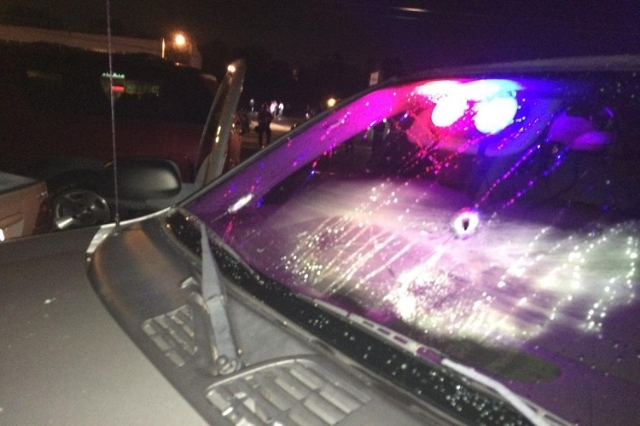 Two St. Louis County Police Department vehicles were damaged by gunfire in the early hours of August 10, 2015, police said. This photo details some of the damage from those gunshots. (St. Louis Co ...