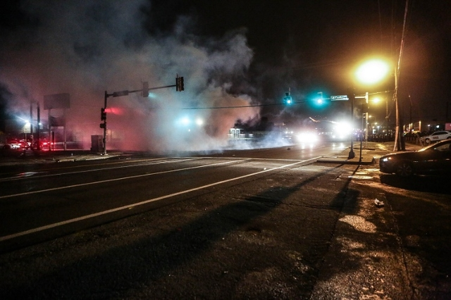 Clouds of smoke fill the street in Ferguson, Missouri on August 9, 2015, as gunfire marred a protest on the anniversary of the death of Michael Brown. (L. Bryant/St. Louis American/CNN)