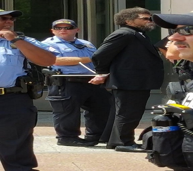 Activist Cornel West was arrested at a peaceful protest in St. Louis. (St. Louis American/CNN)