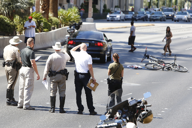 Las Vegas police are investigating a crash that sent a bicyclist to the hospital with life-threatening injuries on the Las Vegas Strip near Spring Mountain Road on Monday morning, Aug. 3, 2015. So ...