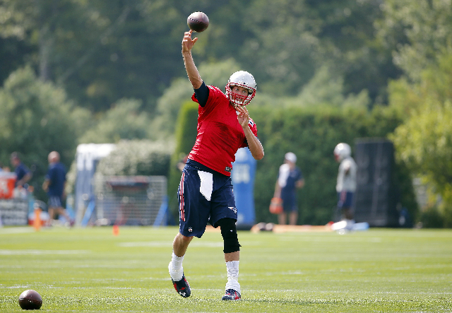 Jul 30, 2015; Foxborough, MA, USA; New England Patriots quarterback Tom Brady (12) throws during training camp at Gillette Stadium. (Winslow Townson-USA Today Sports)