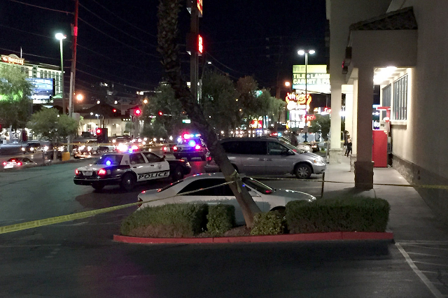 Police investigate a stabbing at a Walgreens, 4905 W. Tropicana Ave., Wednesday night, Aug. 5, 2015. (Chris Kudialis/Las Vegas Review-Journal)