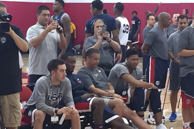 University of Kentucky head coach John Calipari sits between former players John Wall of the Washington Wizards and Anthony Davis of the New Orleans Pelicans at Team USA's Wednesday practice ...