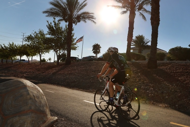 Cyclists take advantage of the cool early morning temperature to ride their bike on St. Rose Parkway trail in Henderson on Monday, Aug. 17, 2015. An excessive heat warning, originally set to expir ...