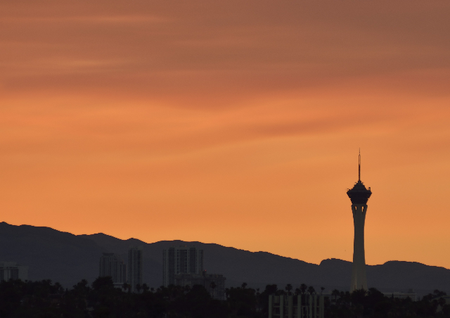 The Stratosphere tower in Las Vegas is shown backed by a sunset believed to be enhanced by smoke from the Big Bear fire on Wednesday, June 24, 2015. (Bill Hughes/Las Vegas Review-Journal)