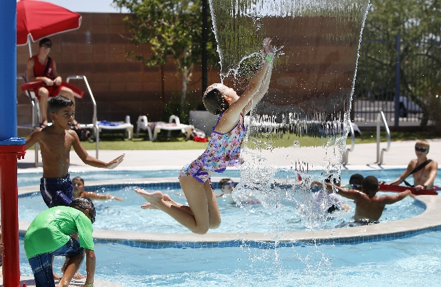 Emma Ambrose (8) plays on a hot day at the YMCA pool on 4141 Meadows Ln in Las Vegas on Tuesday, Aug. 4, 2015. It'll be another sunny day in the Las Vegas Valley on Tuesday with an expected  ...