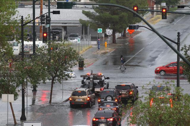 Traffic moves on Las Vegas Boulevard at Bonneville Avenue as heavy rain falls in downtown Las Vegas on Thursday, Aug. 8, 2015. CHASE STEVENS/LAS VEGAS REVIEW-JOURNAL Follow him @csstevensphoto