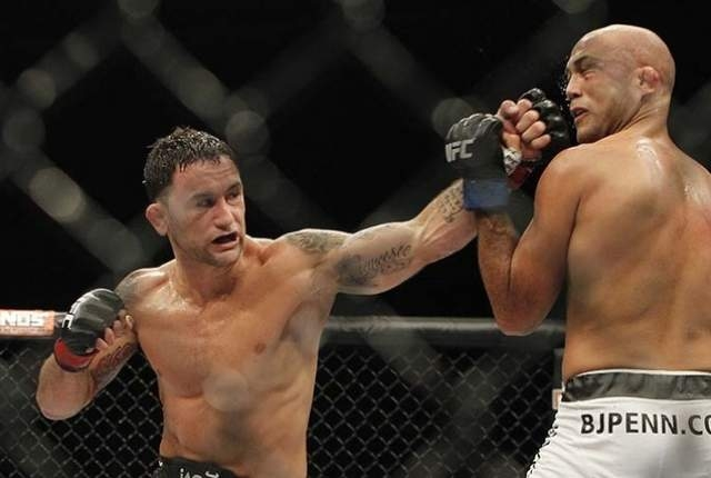 Frankie Edgar hits BJ Penn during their featherweight bout at The Ultimate Fighter 19 Finale at Mandalay Bay in Las Vegas on Sunday, July 6, 2014. (Justin Yurkanin/Las Vegas Review-Journal File)
