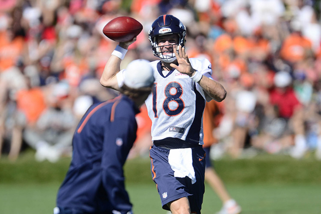 Denver Broncos quarterback Peyton Manning (18) warms up with passing drills during training camp activities at the UCHealth Training Center. (Ron Chenoy/USA TODAY Sports)