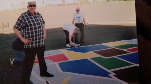 Karl Luebeck and members of the Desert Sands Life Member Club paint a map of the United States at a Las Vegas elementary school. Karl and Mary Luebeck volunteered with the club from the time they  ...