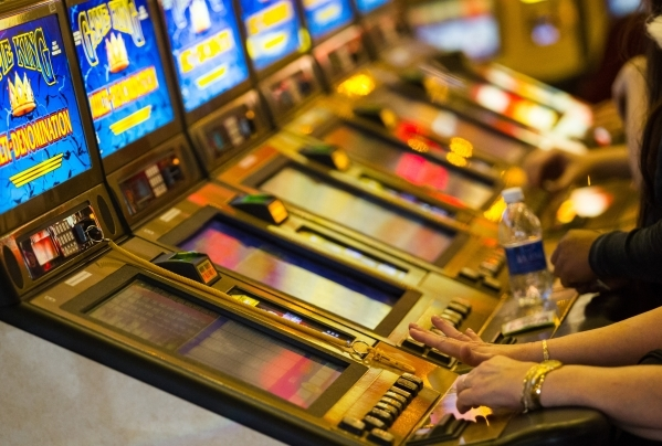 People play on slot machines at Main Street Station May 26. The Problem Gambling Center in Las Vegas was founded in 1998 as a nonprofit supported by the gaming industry to help gambling addicts. ( ...