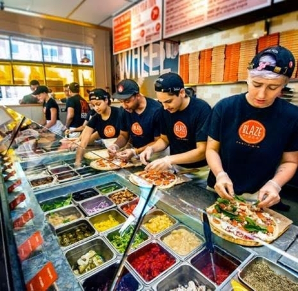 The workers at Blaze Pizza will be busy preparing free pizzas on Friday to celebrate the opening of their new outlet at the Decatur 215 Shopping Center. (Courtesy photo)