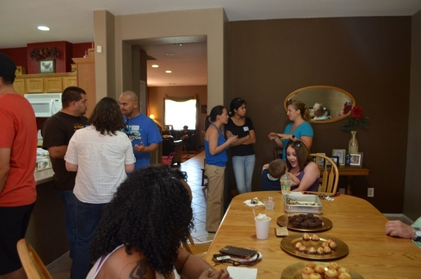 Guests mingle during the monthly Pastor's Coffee at the North Las Vegas home of Pastor Ty Neal and his wife, Angie. Grace Point Church meets at Mojave High School, so the pastor decided to i ...