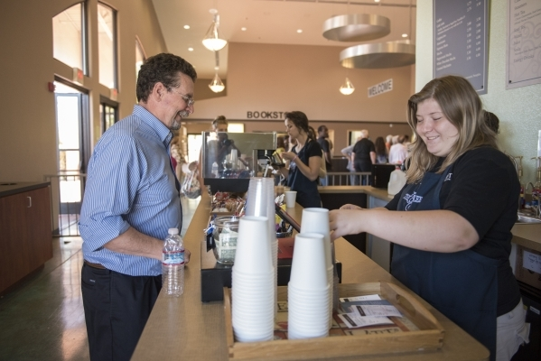 Steve Beason, left, purchases coffee between church services from Saria Walker at The Coffee Tree coffee shop inside the International Church of Las Vegas in Las Vegas on Sunday, Aug. 16, 2015. (M ...