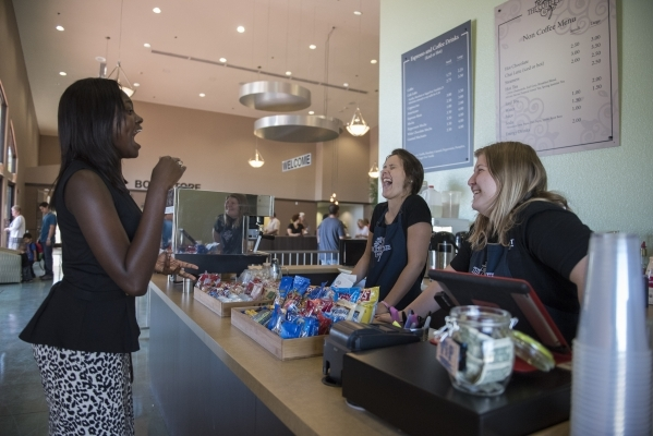 Nana Turkson, left, purchases coffee between church services from Kayleigh Roberson, center, and Saria Walker at The Coffee Tree coffee shop inside the International Church of Las Vegas in Las Veg ...