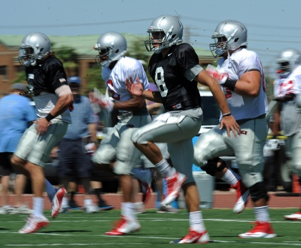 UNLV Rebels quarterback Kevin Thomson (8) and teammates run warm-up drills prior to the start of their inter-squad scrimmage at Nellis Air Force Base in Las Vegas on Saturday Aug. 15, 2015. JOSH H ...