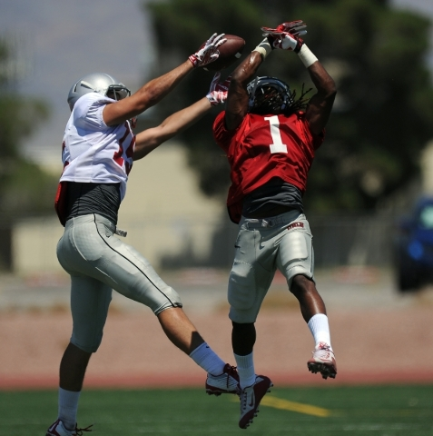 UNLV defensive back Jay'Onn Myles (1) breaks up a pass intended for wide receiver Duke Brunke during the Rebels' intrasquad scrimmage at Nellis Air Force Base on Saturday. JOSH HOLMBER ...