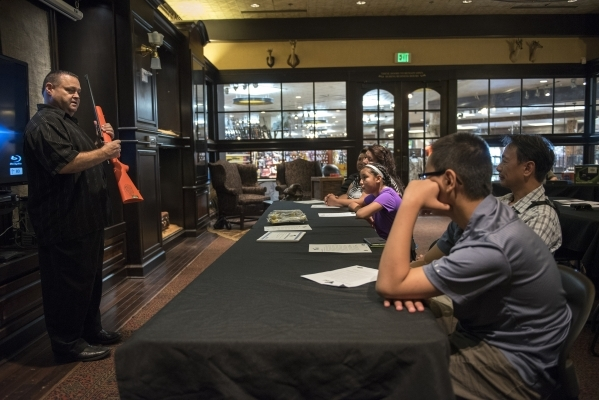 Senior Instructor Kevin McNair, left, of Tactical West conducts a seminar on family firearm safety inside the conservation room at the Bass Pro Shops next to the Silverton hotel-casino in Las Vega ...