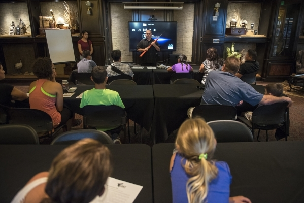Senior Instructor Kevin McNair, top center, of Tactical West conducts a seminar on family firearm safety inside the conservation room at the Bass Pro Shops next to the Silverton hotel-casino in La ...