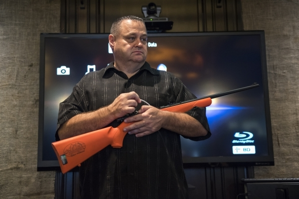 Senior Instructor Kevin McNair of Tactical West conducts a seminar on family firearm safety inside the conservation room at the Bass Pro Shops next to the Silverton hotel-casino in Las Vegas on Sa ...