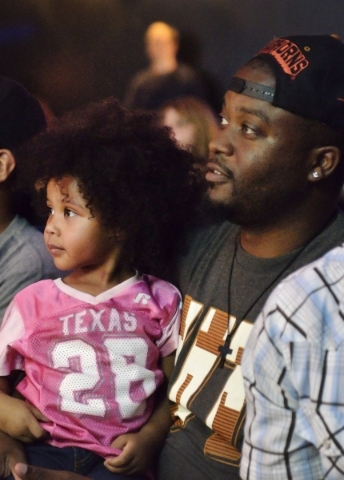 LJ Johnson, right, and his daughter Keilani watch the action on stage during His Hop, a youth program at Family Worship Christian Church at 3945 E. Patrick Lane in Las Vegas on Friday, Aug. 14, 20 ...