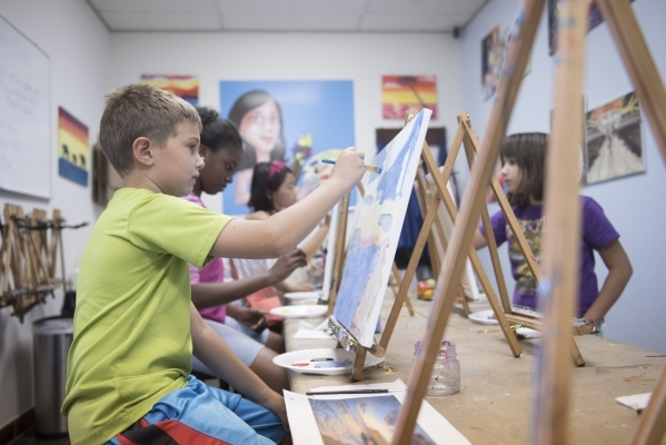 From left, students, Jackson Morell, 7, Torryana Tanis, 11, Justine Retodo, 10, and Emily Parkes, 9, work on their pieces during the group painting class at The King Art Studio in Henderson, Wedne ...