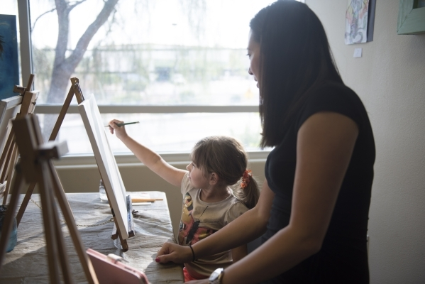 Six-year-old student Leyla Rosles is given instruction by Sarah King during a private painting lesson at The King Art Studio in Henderson, Wednesday, Aug. 19, 2015. (Jason Ogulnik/Las Vegas Review ...