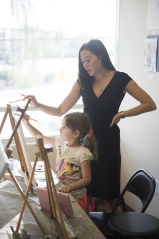 Student Leyla Rosles, 6, is given instruction by Sarah King during a private painting lesson at The King Art Studio in Henderson, Wednesday, Aug. 19, 2015. (Jason Ogulnik/Las Vegas Review-Journal)