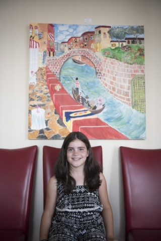 """Alex Mousa, 9, poses with her painting """"A Day In Venice"""" at The King Art Studio in Henderson, Wednesday, Aug. 19, 2015. (Jason Ogulnik/Las Vegas Review-Journal)"""