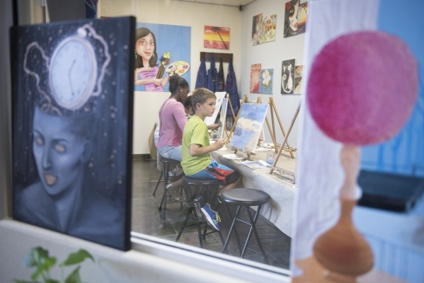 Students work on their pieces during the group painting class at The King Art Studio in Henderson, Wednesday, Aug. 19, 2015. (Jason Ogulnik/Las Vegas Review-Journal)