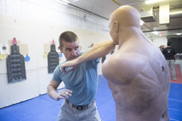 John Ivens demonstrates hand-to-hand combat techniques during The Bodyguard Adventure course at Vegas Tactical Adventures  in North Las Vegas, Aug. 18. (Jason Ogulnik/View)