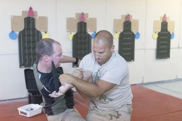 Dave Koopman, left, demonstrates combat techniques against another student during The Bodyguard Adventure course at Vegas Tactical Adventures in North Las Vegas, Aug. 18. (Jason Ogulnik/View)