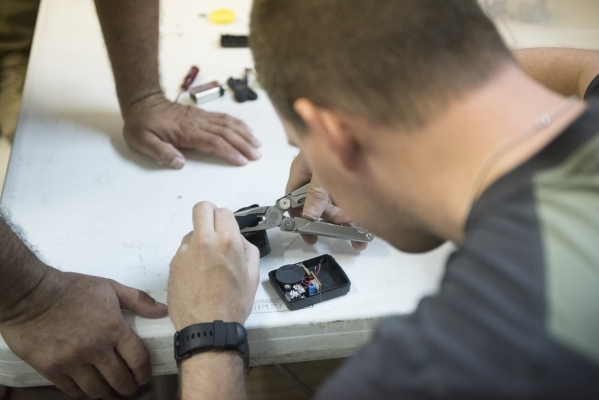 Dave Koopman builds an improvised explosive device to better understand how they work during The Bodyguard Adventure course at Vegas Tactical Adventures in North Las Vegas, Aug. 18. (Jason Ogulnik ...