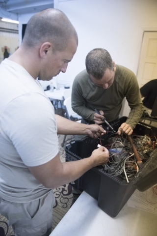Students build improvised explosive devices so that they can better understand how they work during The Bodyguard Adventure course at Vegas Tactical Adventures in North Las Vegas, Aug. 18. (Jason  ...