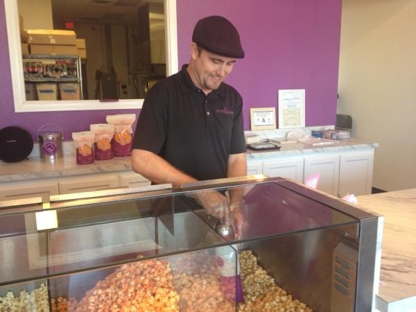 Popularity Gourmet Popcorn owner Eric Biro prepares an order of caramel popcorn inside his Centennial Hills shop, 6640 N. Durango Drive No. 140. (Sandy Lopez/View)