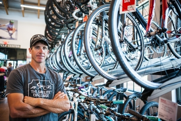 Blue Diamond resident Jared Fisher is shown in his store, Las Vegas Cyclery, 10575 Discovery Drive, which he owns with his wife, Heather. He plans to compete Sept. 16 in the CLIF Bar CrossVegas Wh ...