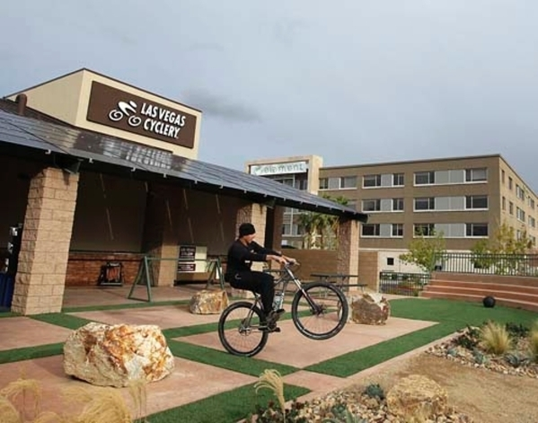 Blue Diamond resident Jared Fisher rides a bicycle outside his store, Las Vegas Cyclery, 10575 Discovery Drive, which he owns with his wife, Heather. He plans to compete Sept. 16 in the CLIF Bar C ...