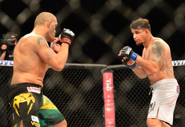 Feb 22, 2015; Porto Alegre, Brazil; Antonio Silva (red gloves) fights against Frank Mir (blue gloves) during UFC Fight Night at Ginasio do Gigantinho. Mandatory Credit: Jason da Silva-USA TODAY Sports