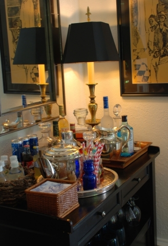 Approach styling your bar as you would any other display in your home, with an eye for details and drama. (Handout/TNS)