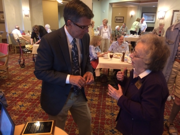 Tom Warden, senior vice president of community and government relations for Summerlin and The Howard Hughes Corp., takes a question from a resident of Las Ventanas where he spoke to residents July ...